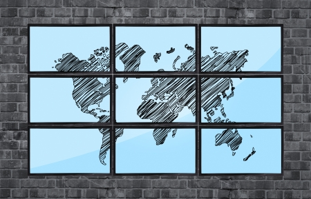 map of world on flat panels on brick wall photo