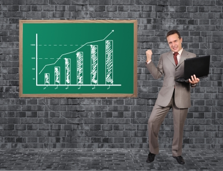 happy businessman and schedule growth on blackboard photo