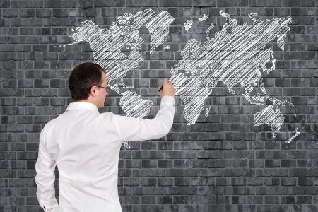 Businessman drawing world map on wall stock photo picture and businessman drawing world map on wall stock photo picture and royalty free image image 17750174 gumiabroncs Choice Image