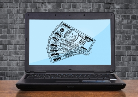 laptop with drawing dollar on monitor Stock Photo - 17970660