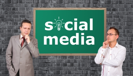 two businessman and social media symbol on board photo