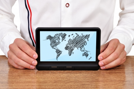 man with digital tablet with world map in hand Stock Photo - 18021626