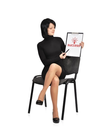 singn: businesswoman sitting on chair with success symbol on clipboard