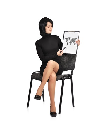 singn: businesswoman sitting on chair and clipboard with world map Stock Photo