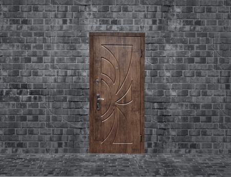 wooden door in brick room