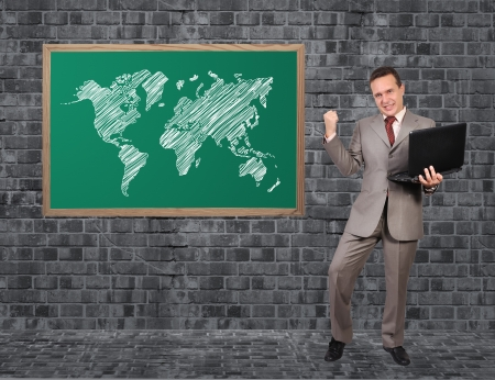 happy businessman and word map on blackboard photo