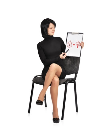 singn: businesswoman sitting on chair with business formula on clipboard Stock Photo