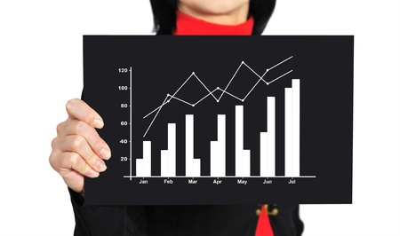 woman holding black paper with graph of profit photo