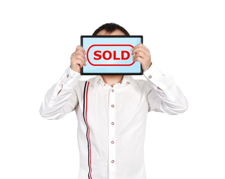 businessman holding touch pad with sold symbol photo