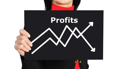 woman holding paper with graph of profit photo