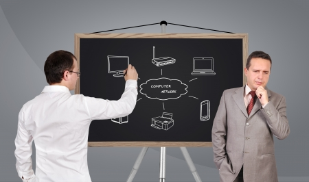 two businessman and  computer network on blackboard photo