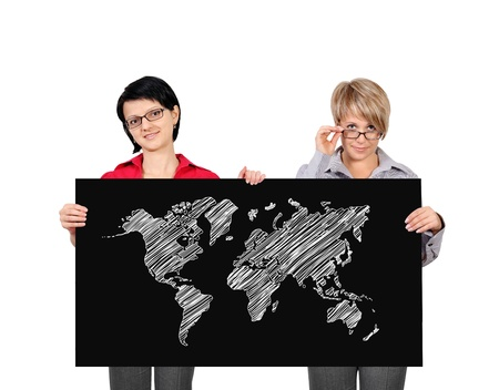 two businesswoman holding poster with wopld map photo