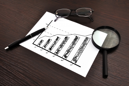 workplace with growth chart on paper Stock Photo - 20429445