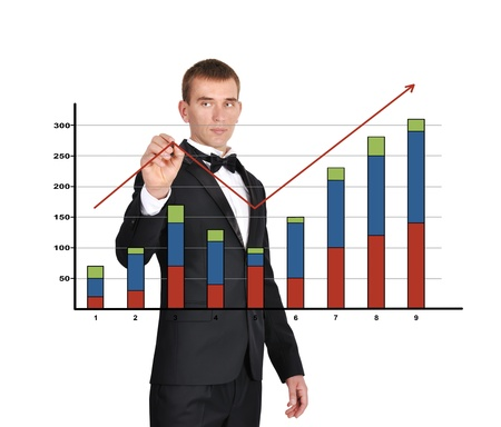 businessman in tuxedo drawing chart of profits photo