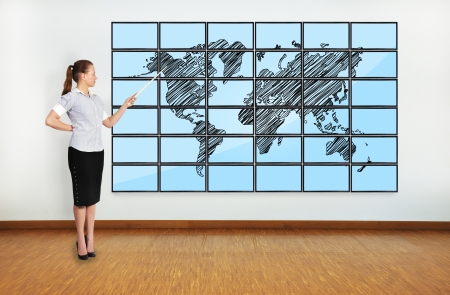 businesswoman pointing at world map on plasma photo