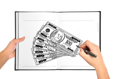 hand drawing money in book photo