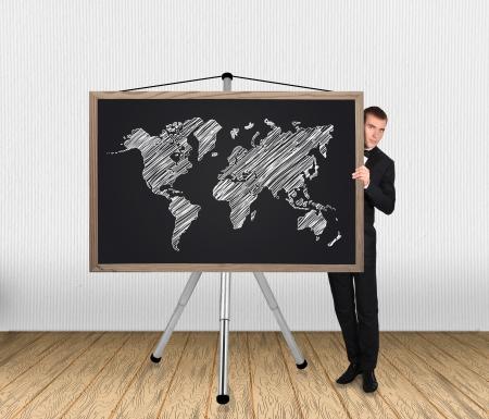 businessman in tuxedo and world map on blackboard photo