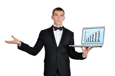 businessman in tuxedo holding laptop wirth chart photo