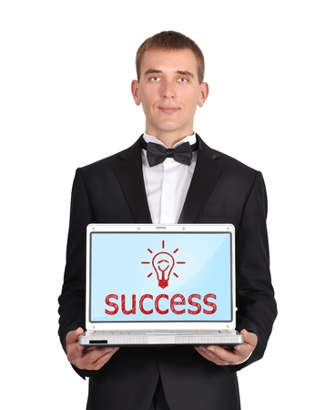 businessman holding laptop wirth success symbol photo