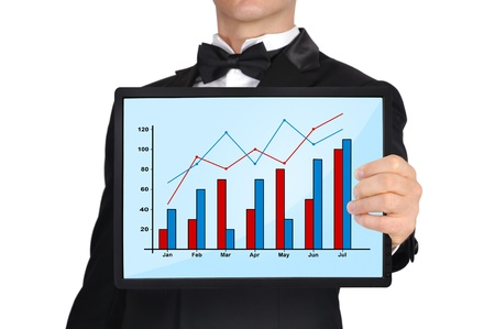 businessman in tuxedo holding tablet with business chart photo