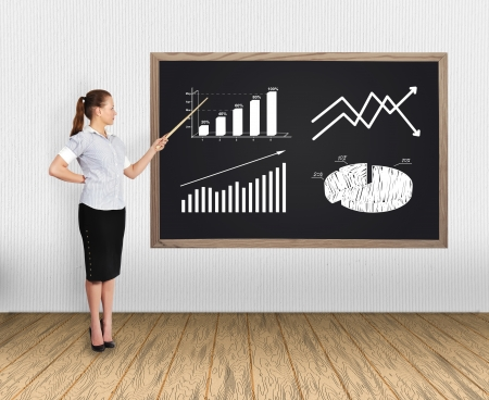 businesswoman in office pointing at charts photo