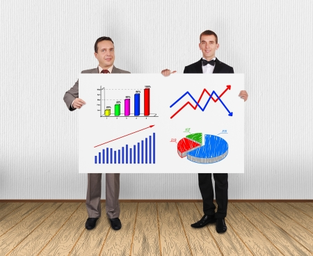two businessman holding placard with charts in office photo
