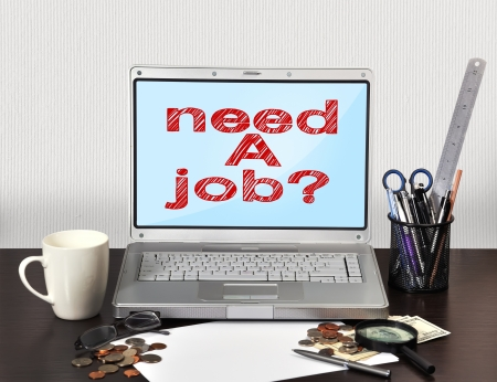 notebook with stationery and need a job on screen photo
