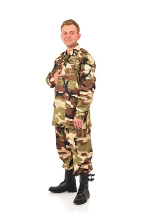 fatigues: man in camouflage clothing on a white background Stock Photo