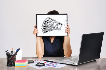 businesswoman holding a clipboard with dollar photo