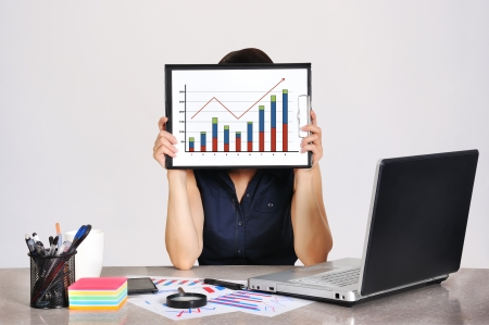 businesswoman holding clipboard with drawing chart photo