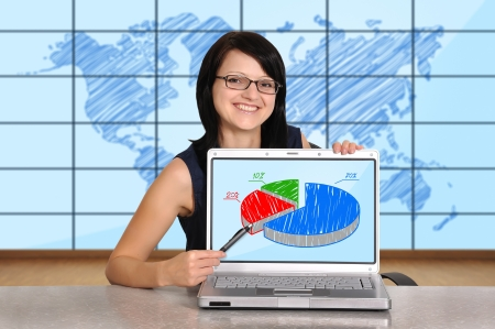 woman sitting in office and pointing to chart photo