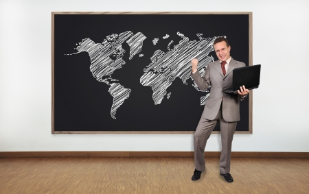 happy  businessman and blackboard with world map photo