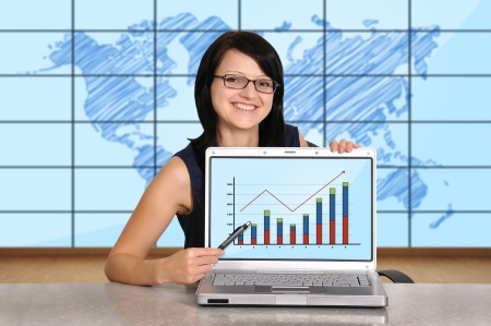 woman sitting in office and laptop with chart photo