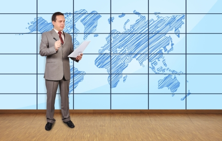 businessman in office and world map on plasma wall photo