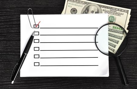 poster with check box and money in the office Stock Photo