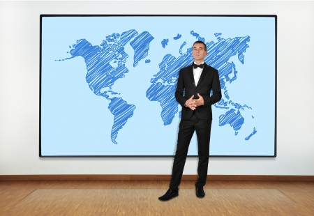 businessman in office and big plasma with world map photo