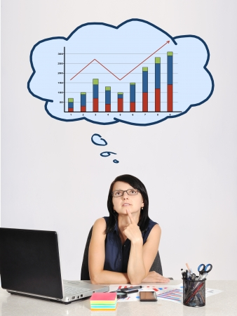 thinking businesswoman in office and speech bubbles with chart photo
