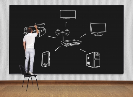 man standing on a chair and drawing computer network Stock Photo - 22403053