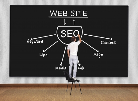 man standing on a chair and drawing seo concept Stock Photo - 22403054
