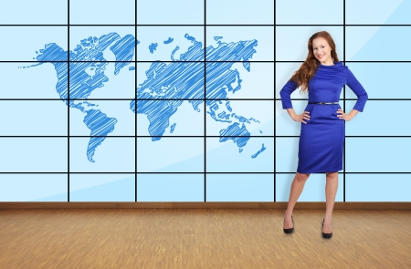 beautiful girl standing in office and big plasma with map photo