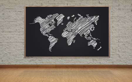 blackboard with drawing world map on brick wall photo