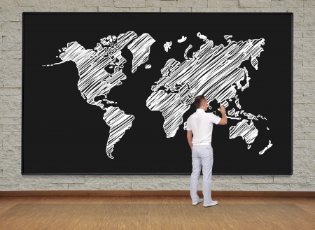man standing and drawing world map photo