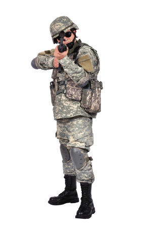 fatigues: soldier with his assault rifle on white background