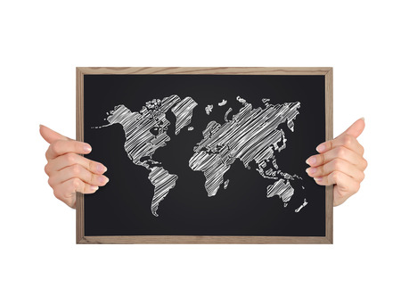 hands holding blackboard with world map photo
