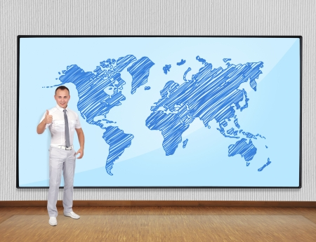 businessman showing thumb up and screen with world map photo