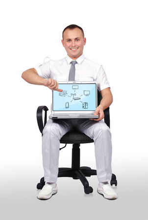 businessman sitting in chair and holding laptop with computer network photo