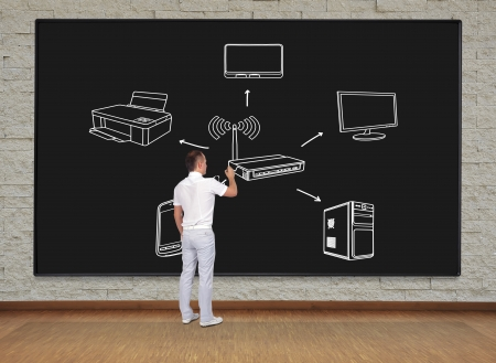 businessman standing and drawing scheme computer network Stock Photo - 22867233