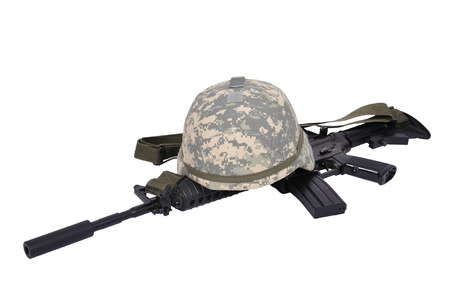 assault rifle and helmet  on white  photo