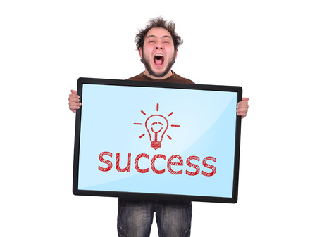 crazy man holding plasma panel with success photo