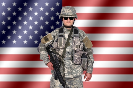 army camo: US soldier with his assault rifle on flag background